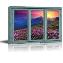 wall26 - A Colorful Sunset Over Blue Mountains and Rocky Soil with Pink Flowers in Bloom - Canvas Art Home Decor - 24x36 inches