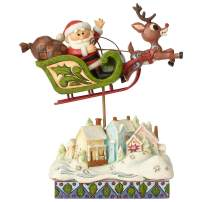 """Enesco Rudolph The Red Nosed Reindeer by Jim Shore Sleigh Over Village Figurine, 7.2"""", Multicolor"""