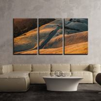 "wall26 - 3 Piece Canvas Wall Art - Long Road Through Bare Hills at Sunset - Modern Home Decor Stretched and Framed Ready to Hang - 16""x24""x3 Panels"