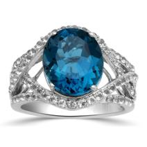 Jewelili Sterling Silver 12x10mm Oval London Blue Topaz and Round White Topaz with 1.5mm Round Emerald on Side Halo Ring