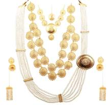 Touchstone Indian Bollywood Faux Pearls Beaten Metal Bahubali Fame Elaborate and Dramatic Complete Bridal Designer Jewelry Necklace Sets Combo for Women in Gold Tone.