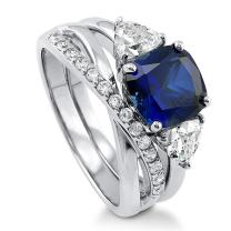 BERRICLE Rhodium Plated Sterling Silver Simulated Blue Sapphire Cushion Cut Cubic Zirconia CZ 3-Stone Infinity Engagement Wedding Ring Set 4 CTW
