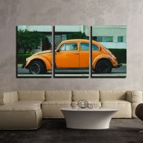"""wall26 - 3 Piece Canvas Wall Art - Antique Orange Car Parked in Front of a Building - Modern Home Decor Stretched and Framed Ready to Hang - 24""""x36""""x3 Panels"""