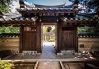 AOFOTO 6x4ft Korean Garden Wooden Door Entrance Backdrop Asian Confucianist Village Korea Traditional Tile-Roofed House Old Park Buildings Stone Background for Photography Photo Studio Props Vinyl