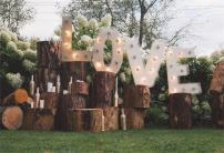 AOFOTO 10x8ft Love Wedding Ceremony Backdrop Rural Wood Stakes Marriage Proposal Decoration Banner Photography Background Courtship Girlfriend Lovers Couple Fiancee Bridal Shower Garden Nuptial Props