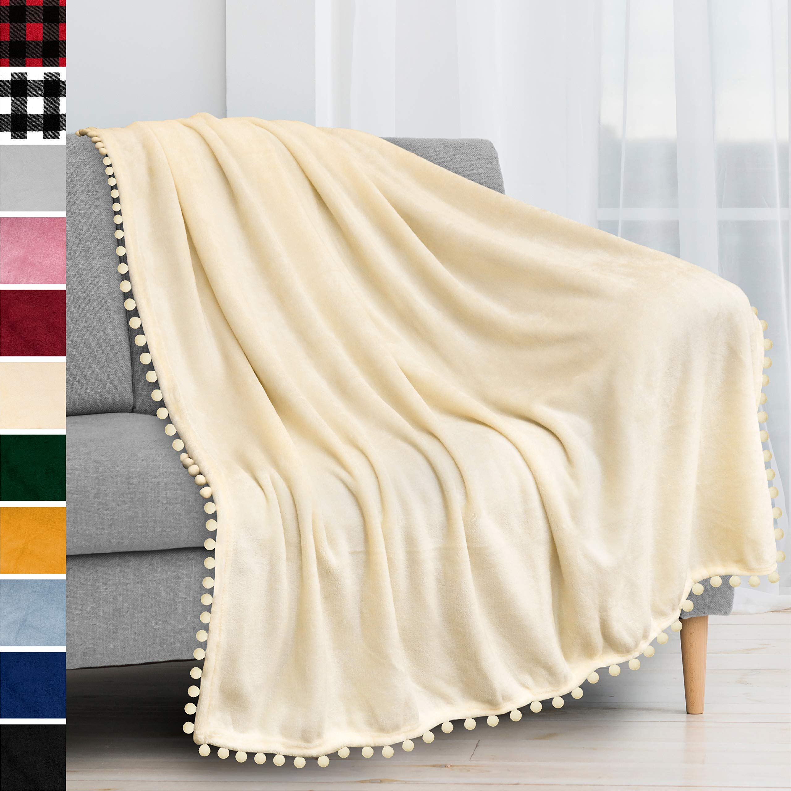 PAVILIA Fleece Throw Blanket with Pom Pom Fringe   Ivory Cream Flannel Throw   Super Soft Lightweight Microfiber Polyester   Plush, Fuzzy, Cozy, Beige White   50 x 60 Inches
