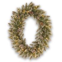 National Tree 30 Inch by 21 Inch Glittery Bristle Pine Oval Wreath with Cones and 50 Battery Operated Warm White LED Lights (GB3-307-30WBC)