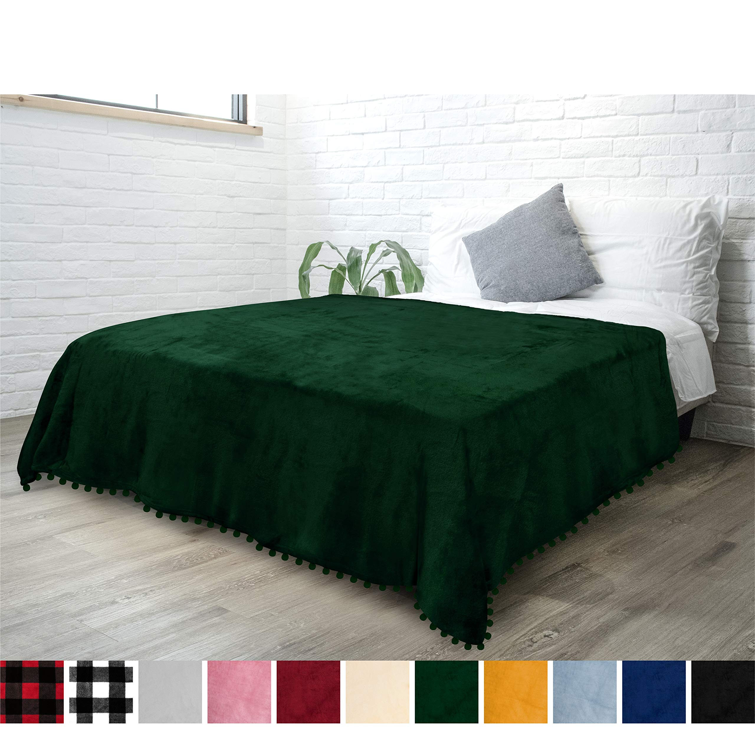 PAVILIA Fleece Throw Blanket with Pom Pom Fringe | Emerald Green Flannel Throw | Super Soft Lightweight Microfiber Polyester | Plush, Fuzzy, Cozy, Dark Green | 60 x 80 Inches