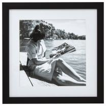 """Amazon Brand – Stone & Beam Black and White Reading by the Water Photo Wall Art Decor - 18"""" x 18"""" Picture Frame, Black"""