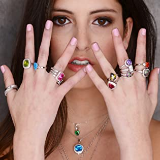 Star K founder wearing colorful rings and necklaces