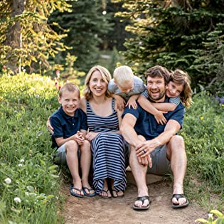 Bump and Beyond Designs founder and family sitting in a garden
