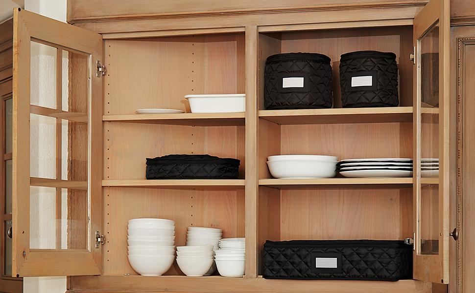 Black dish storage in a kitchen cabinet