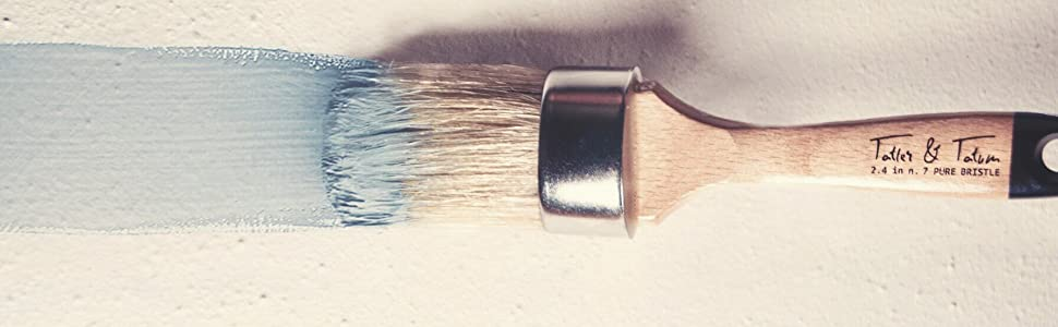 Light blue paint on brush and a light blue paint streak
