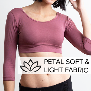 """A woman wearing a pink long-sleeved Halftee. Says """"petal-soft & light fabric."""""""