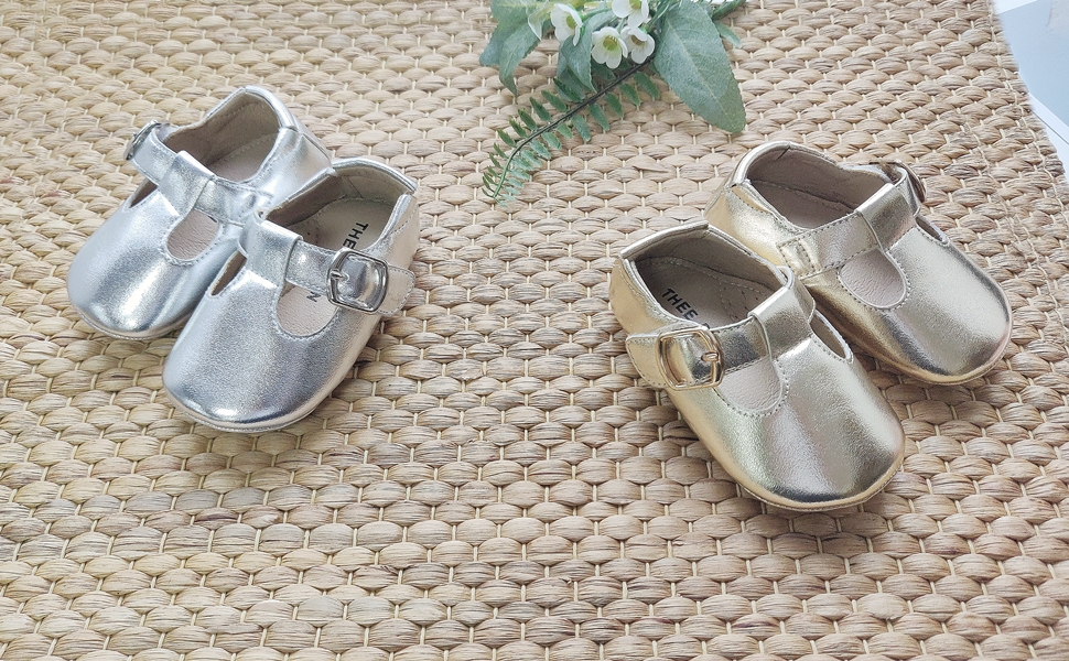 silver and gold baby shoes