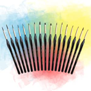 fanned out brushes on colored background