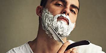 man shaving in mirror bib and tucker
