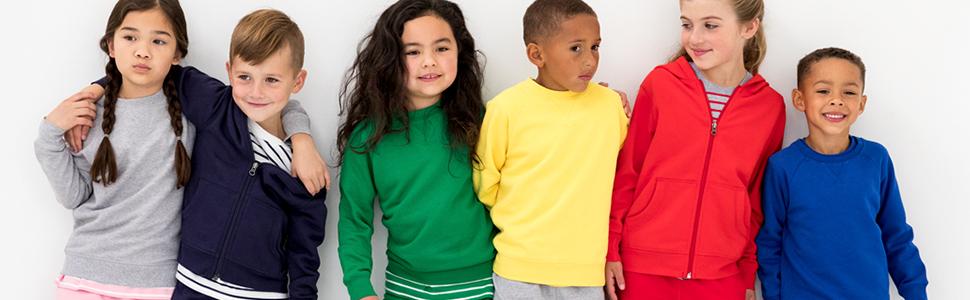A group of kids wearing a collection of Hanna Andersson garments.