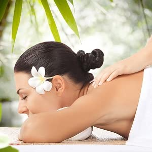 Woman laying on table getting massage
