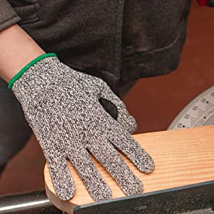 Image of a hand wearing cut resistant gloves.