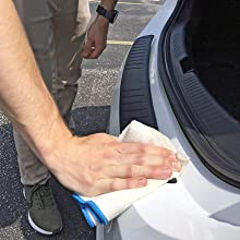 Image Instructing To Press Firmly Down On The Bumper Cover To Ensure Proper Adhesion