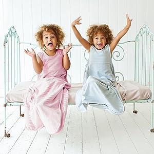 go go sleep bag worn by twins merino kids