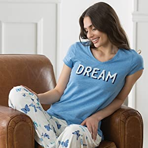 Woman in blue pajamas in a chair