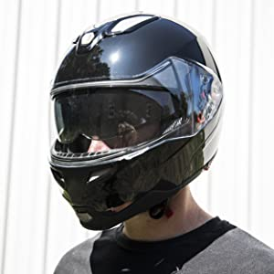 motorcycle helmet with drop down sun shield tinted