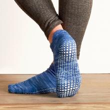 Close up of blue yoga sock on model showing white maximum sticky grip