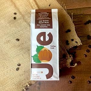 Simple white packaging. A fan favorite, hazelnut flavored ground coffee.