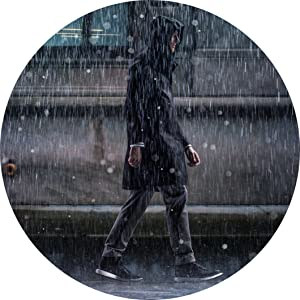 man walking under the rain
