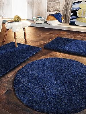 Rich navy blue baths mats in modern bathroom. Plush, shaggy bath mats, non - slip