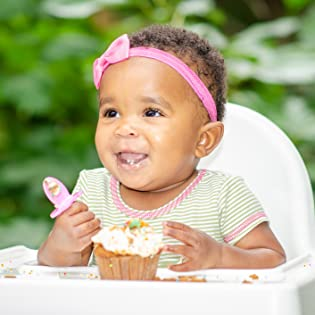 baby with a spoon eating food