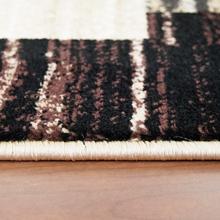 Soft short pile brown rug