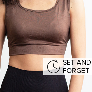 """A woman wearing a brown sleeveless Halftee. Says """"set and forget."""""""