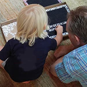Child learning from felt letter board