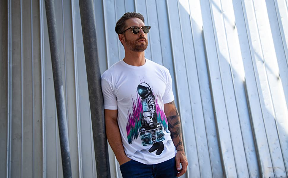 into the am model wearing white astroblaster graphic tee astronaut t-shirt
