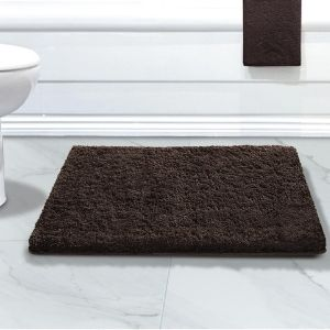 Close up of brown bathmat in marble mathroom non slip backing makes safe on all floor types