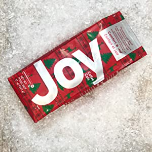 Holiday red and green packaging. Peppermint bark flavored ground coffee