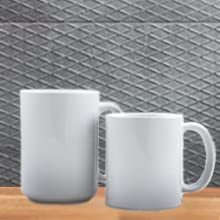 11 oz and 15 oz white glossy ceramic mugs sitting side by side on table