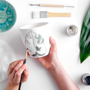 painting ceramics cup with wood handle brush