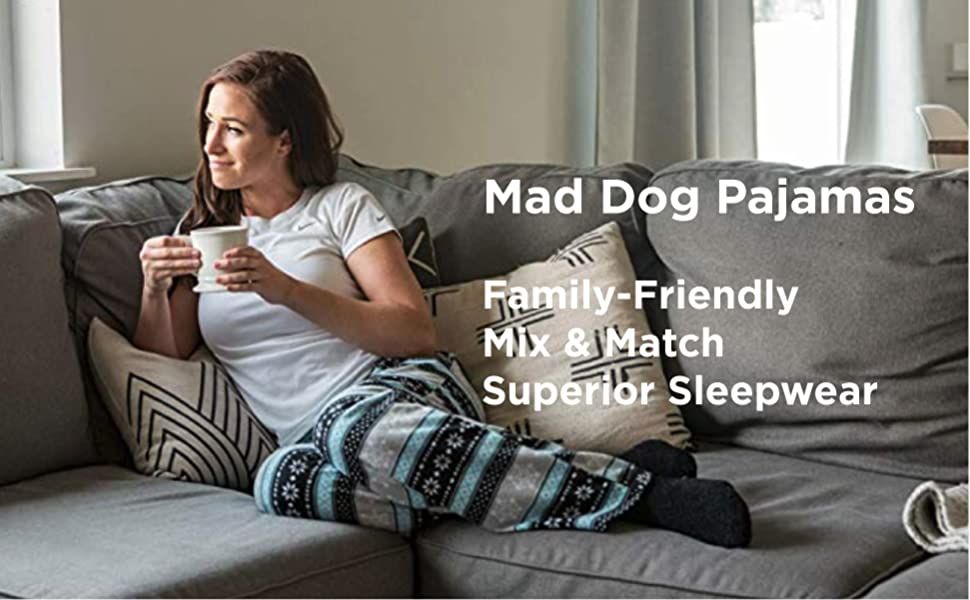 Woman wearing Mad Dog pajamas while enjoying a hot drink on the couch