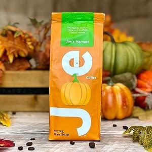 Bright, burnt orange packaging. Pumpkin spice flavored ground coffee