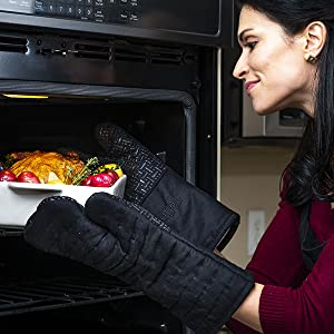 Person removing hot pan from over using XLNT Silicone Oven Mitts.