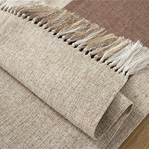 table runner with fringe decorations for party table