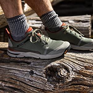 hiking shoe on log