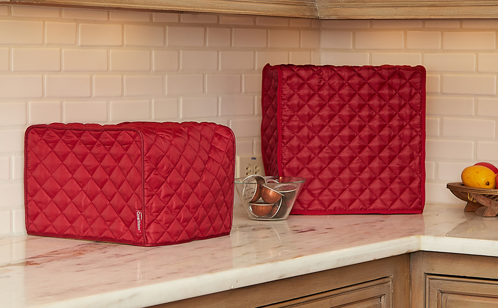 Two red kitchen appliance covers on a counter top