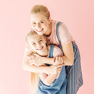Mother & daughter on pink background paper