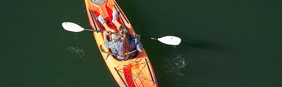 woman paddling her canoe