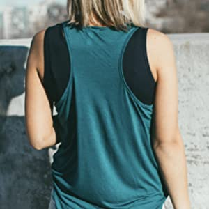 The back of a woman who is wearing a sleeveless cardigan with a black Halftee underneath.